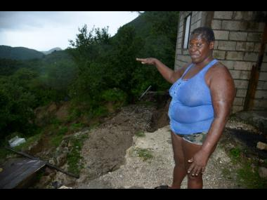 Gaylia Catwell said that she is afraid to sleep in her house after a landslide claimed much of her backyard in Lindo's Gap, St Andrew, on Sunday.