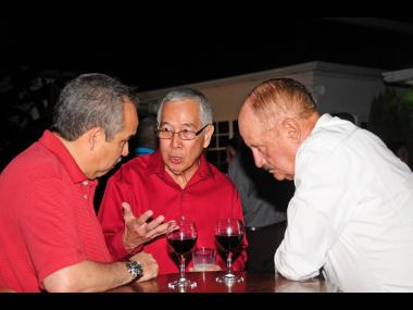 Caribbean Stalwart: Joseph Lowe (centre) was always willing to share his wealth of knowledge and is pictured doing so with Carlos Urriola (left) and Fernando Rivera, both past presidents of the Caribbean Shipping Association (CSA), at an annual meeting of