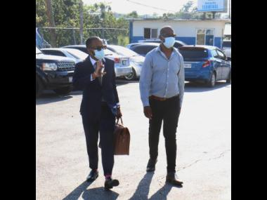 Able Don-Foote (left), attorney-at-law, reports to the  Montego Bay Police Station with his client, George Wright, member of parliament for Westmoreland Central, in relation to the alleged beating of a woman. An altercation captured on CCTV later became a