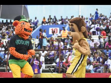 ISSA/GraceKennedy Boys and Girls' Athletics Championships mascot Champsy (right) celebrates with the Jamaica Anti-Doping Agency mascot Leo at Champs on Friday, March 23, 2018.