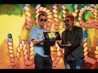 Joe Bogdanovich (left), Reggae Sumfest executive producer and chairman and CEO of Downsound Entertainment, presents the Sumfest Lifetime Achievement Award to Third World member Stephen 'Cat' Coore during the virtual 2020 staging of Reggae Sumfest. Bogd