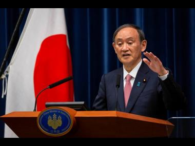 Japanese Prime Minister Yoshihide Suga speaks during a press conference at the prime minister's official residence on Friday, May 14, in Tokyo.