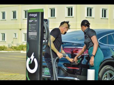 Moya-Mae Rose, Promotions Officer, Evergo, facilitates a demonstration with Nick Lue, car enthusiast, on how to use Evergo's Level 2 Charging Station. Evergo's Level 2 charger is compatible with both Battery Electric Vehicles (BEVs) and Plug-in Hybrid