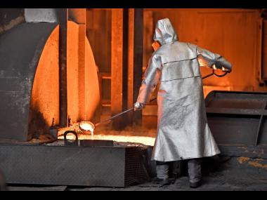 In this April 27, 2018 photo, a worker controls iron at the Thyssenkrupp steel factory in Duisburg, Germany.