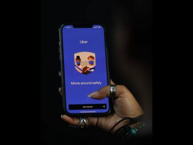 A cell phone user navigates the popular ride-share app Uber to seek a ride in Kingston, Jamaica. The company announced on Tuesday that it was operational in the island.