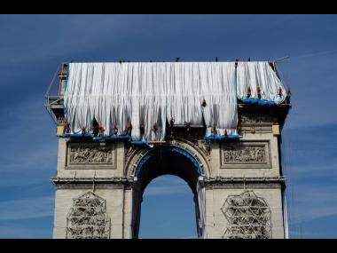 Workers wrap the Arc de Triomphe monument on September 12. The 'L'Arc de Triomphe, Wrapped' project by late artists Christo and Jeanne-Claude will be on view from September 8 to October 3. The famed Paris monument has been wrapped in 25,000 square me