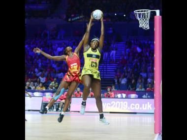 Jamaica's Jhaniele Fowler (right) outjumps Uganda's Muhayimina Namuwaya to collect a pass during the Netball World Cup at the M&S Bank Arena in Liverpool, England, on Thursday, July 18, 2019.