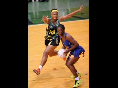 In this file photo from May 2017, Jamaica's Thristina Harwood (left) attempts to block a pass from Barbados' Teresa Howell during a test match between the sides at the National Arena in Kingston.