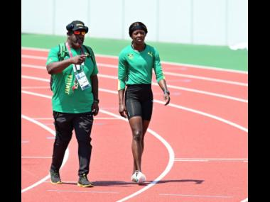 Coach Paul Francis speaking with Shericka Jackson at a training session with the national Olympic Games athletics team, at the Edogawa City Athletic Stadium in Tokyo, Japan, on Thursday July 29, 2021.