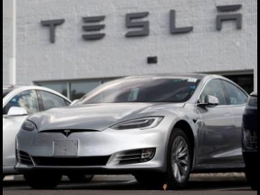 This file photo shows Tesla 2018 Model 3 sedans.