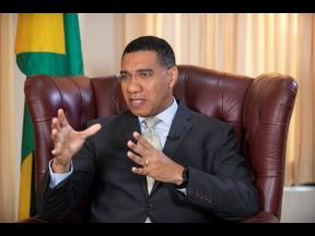 Prime Minister Andrew Holness gestures during an interview at Jamaica House yesterday.
