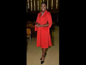 One of the youngest appointed senators, communication specialist Gabriella Morris makes a statement in a bold red wrap-and-tie dress.