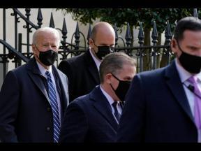 President Joe Biden (left), departs after attending mass at Holy Trinity Catholic Church on Sunday, in the Georgetown neighbourhood of Washington.
