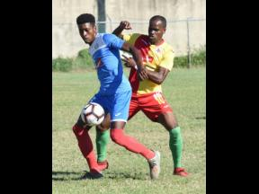 Portmore United's Shai Smith (left) shields the ball from Humble Lion's Levaughn Williams during their Jamaica Premier League match at the Spanish Town Prison Oval on Sunday, January 5, 2020.