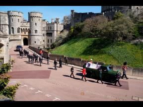 Family members follow the coffin during a procession arriving at St George's Chapel for the funeral of Britain's Prince Philip inside Windsor Castle in Windsor, England, on Saturday. Prince Philip died April 9 at the age of 99 after 73 years of marria