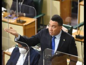 Prime Minister Andrew Holness gestures during his address to lawmakers in the House of Representatives on Tuesday.
