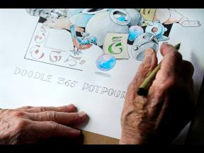 Artist Robert Seaman works on his 365th daily doodle in his room at an assisted living facility in Westmoreland, N.H. Seaman, who moved into the facility weeks before the COVID-19 pandemic shut down his outside world in 2020, recently completed his 365th d