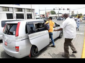 Passengers board a taxi in the high-traffic hub of Half-Way Tree, St Andrew, on Wednesday. Cabbies are concerned that the entry of Uber into the local market could further marginalise licensed taxi operators.