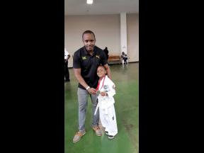 Kamal Powell (left), and his son, Marcus, following a karate tournament.