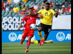 Jamaica's Damion Lowe (right) and Panama's Gabriel Torres battle for the ball during the first half of a Concacaf Gold Cup match in Philadelphia, Pennsylvania, in June 2019.