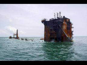 This photo provided by the Sri Lankan navy shows the sinking 'MV X-Press Pearl' off Colombo port, Sri Lanka, on Thursday, June 17. The container ship carrying chemicals sank off Sri Lanka's capital on Thursday nearly a month after catching fire, rais