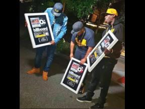 Members of the Wu-Tang Clan show off the plaques they received for 'Tropical House Cruises to Jamaica: The Reggae Collector's Edition', which hit number 16 on the Billboard Compilation Album chart.