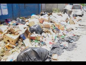 Uncollected garbage piled up at Manchester Street, Spanish Town.