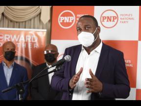 PNP General Secretary Dr Dayton Campbell addressing a press conference on Monday.