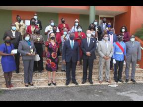 Manchester Custos Garfield Green and British High Commissioner Judith Slater celebrate with justices of the peace and medical professionals during a ceremony to honour their commitment to the COVID-19 fight in the parish at Church Teachers' College in Ma