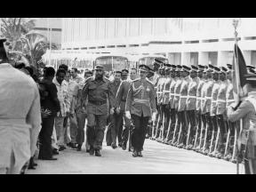 Cuba's President Dr Fidel Castro, inspecting the guard of honour of the First Battalion, The Jamaica Regiment. Escorting him on the inspection was Major-General Rudolph Green, Chief of Staff of the Jamaica Defence Force.