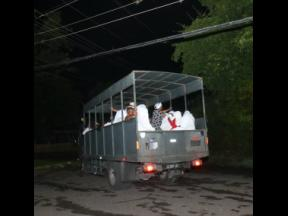 Members of The Pathways International Restoration of Montego Bay  being taken away in a JDF vehicle.