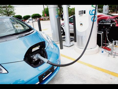 A Nissan Leaf Motor Vehicle Is Charged During Demo At The First Ever Quick Charge Electric Charging Station In State Of Texas Located