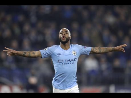 Manchester City forward Raheem Sterling celebrates after scoring the winning goal against Schalke in the Champions League match at Veltins Arena in Gelsenkirchen, Germany, yesterday.  City won 3-2.