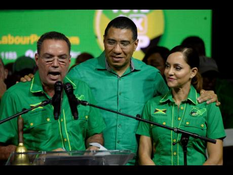 West Portland Member of Parliament Daryl Vaz fires up the crowd at a Jamaica Labour Party campaign rally in Port Antonio last night as JLP leader Andrew Holness and East Portland caretaker Ann-Marie Vaz look on.