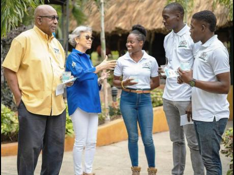 Director of Caribbean Broilers Group Lori-Ann Lyn (second left) with Sonique Bennett, Renardo Stone, and Christian Jones, three of the Nutramix 2019 Youth in Agriculture Ambassadors, as Caribbean Group Director Dr Keith Amiel looks on.