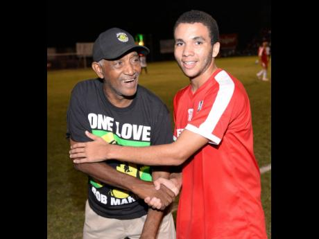 Organiser Clive 'Busy' Campbell (left) and one of Bob Marley's grandsons, Kristian Marley, share a light moment at the Bob Marley One Love football match at Anthony Spaulding Sports Complex in 2016. The charity event returns to the venue this Wednesday.