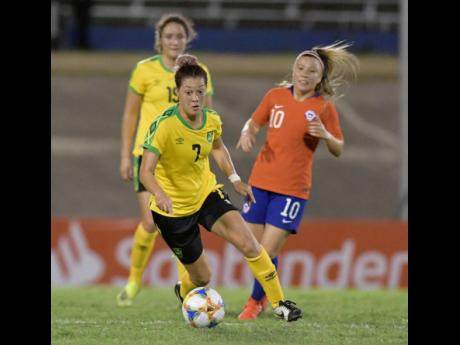 Reggae Girl Chinyelu Asher (centre) is all focus during Jamaica's 1-0 win over Chile in their friendly international at the National Stadium last Thursday.