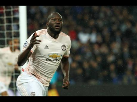 Manchester United's Romelu Lukaku celebrates after scoring his side's opening goal during the Champions League round of 16, second-leg match between Paris Saint Germain and Manchester United at the Parc des Princes stadium in Paris, France, yesterday.
