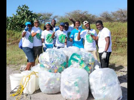 Members of Team FLOW strike a pose following the Wisynco Beach Clean-up activity to launch its participation in the Wisynco Eco Plastic Recycling Challenge at Fort Rocky on February 23.