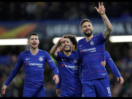 Chelsea's Pedro Rodriguez (centre) celebrates with his teammates Olivier Giroud (right) and Jorginho after scoring the opening goal during the Europa League round of 16, first-leg match against Dynamo Kyiv at Stamford Bridge stadium in London yesterday.