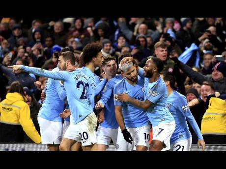 Manchester City's Sergio Aguero (second right) celebrates with teammates after scoring the opening goal of the game during their English Premier League  match against Liverpool at the Etihad Stadium in Manchester, England, earlier this year.