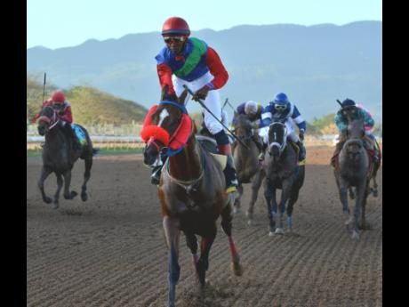 SUPERLUMINAL (Omar Walker) captures yesterday's feature race, The Kings Plate over 1500 metres, at Caymanas Park.
