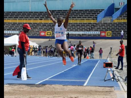 Immaculate Conception's Onanda Lowe competing in the Girls Class Three Long Jump at the Digicel/Anthrick Corporate Area Championships held at The National Stadium on March 8, 2019.