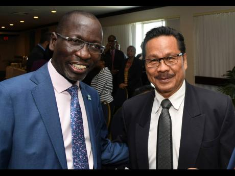 Collen Kelapile (left), Botswana ambassador to Jamaica, and Alfred Palembangan, Indonesian high commissioner, attending the meeting of diplomatic heads at the Ministry of Foreign Affairs and Foreign Trade. The event was held at The Jamaica Pegasus in New Kingston yesterday.