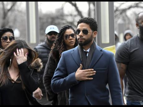 Empire actor Jussie Smollett, centre, arrives at the Leighton Criminal Court Building for his hearing yesterday, in Chicago. Smollett is accused of lying to police about being the victim of a racist and homophobic attack by two men on Jan. 29 in downtown Chicago. (AP Photo/Matt Marton)