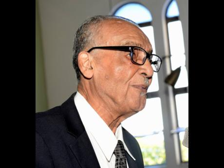 Pastor Ralston Getfield delivering the remembrance during the funeral for former sports editor of The Gleaner, Tony Becca, at  St Matthew's Anglican Church in Allman Town, Kingston, yesterday.