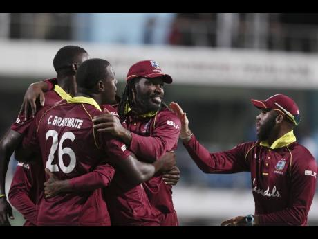 The Windies One-Day International cricket team celebrates beating England by 26 runs in the second One Day International cricket match at the Kensington Oval in Bridgetown, Barbados, on Friday, February 22, 2019.