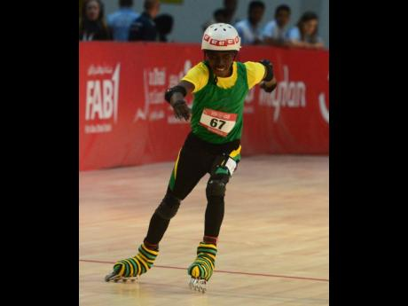 Jamaica's Dale Oddman wins gold in the 300m rollerskating event of the Special Olympic World Summer Games at the National Exhibition Center in Abu Dhabi, United Arab Emirates, on Sunday.