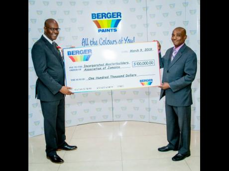 Berger Paints, through the Incorporated Masterbuilders Association of Jamaica (IMAJ), donated $100,000 towards a scholarship fund for students pursuing an architectural degree. Lenworth Kelly (left), president of the IMAJ accepts the cheque from Barrington Graham, general manager, Berger Paints Jamaica Limited.