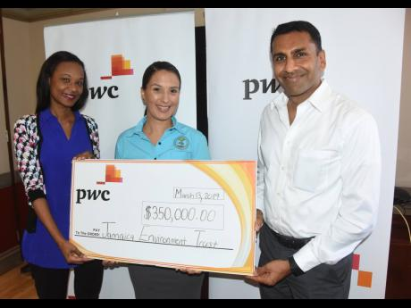 Gail Moore (left), environment lead partner and Alok Jain, regional advisory leader, PwC Jamaica, present a cheque for $350,000 to Suzanne Stanley, CEO of the Jamaica Environment Trust.